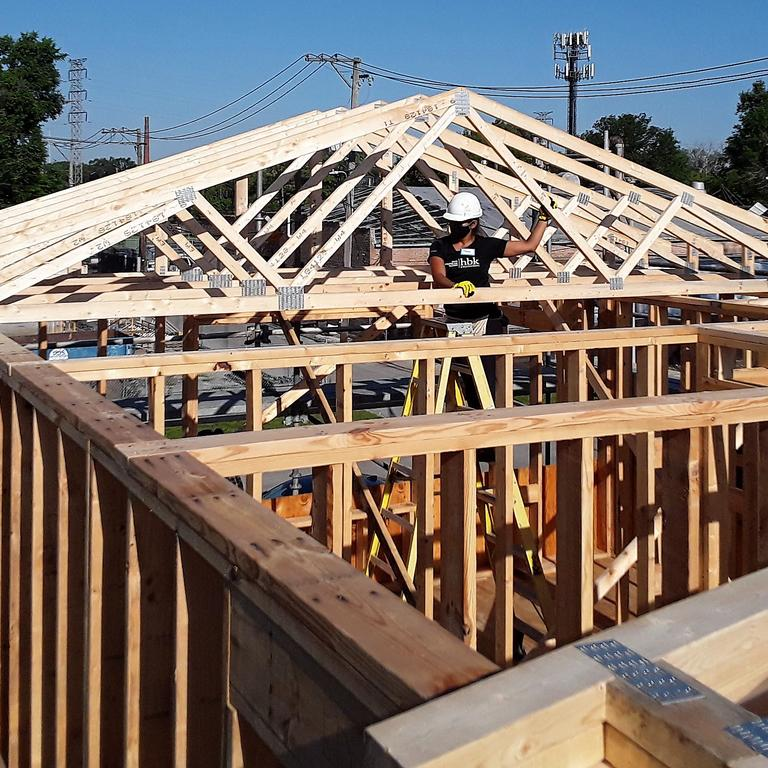 HBK employees work on trusses for a new Habitat for Humanities home.